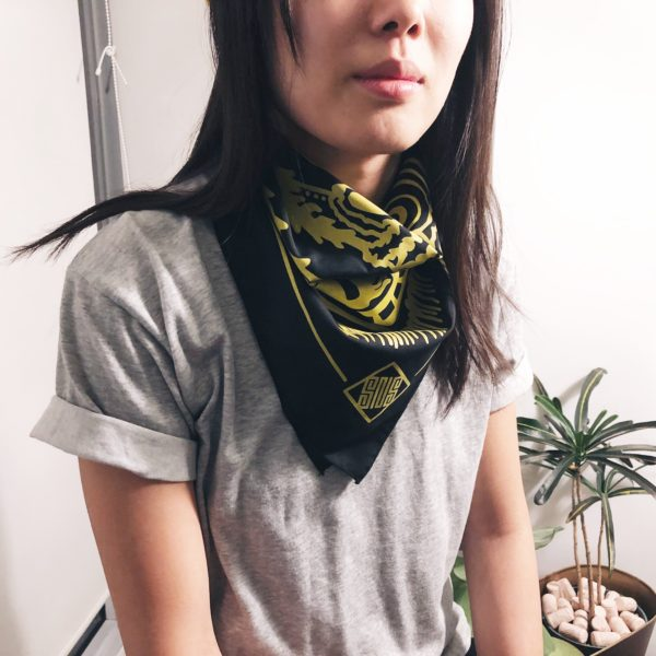 Woman wearing a bandana around her neck