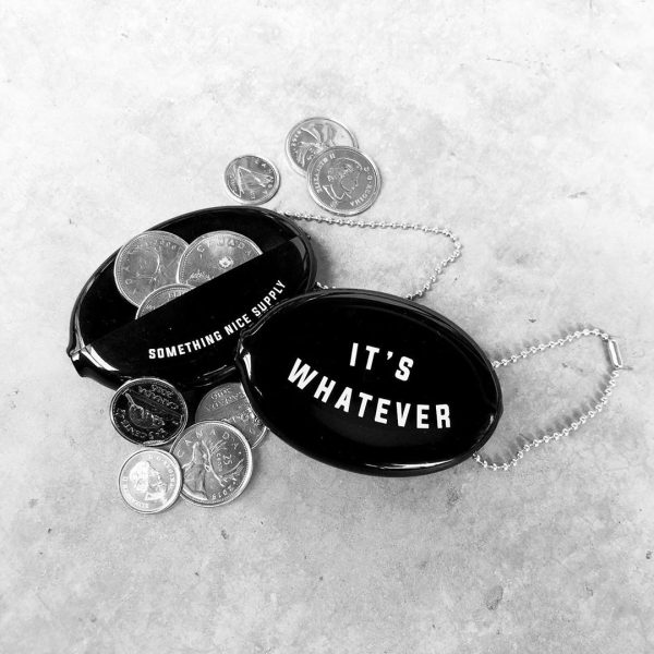 "Two black rubber coin wallets. One shows the words ""It's Whatever"" on the front. The second one shows the back which says ""Something Nice Supply"" near the opening. There are a few coins around the pouch."